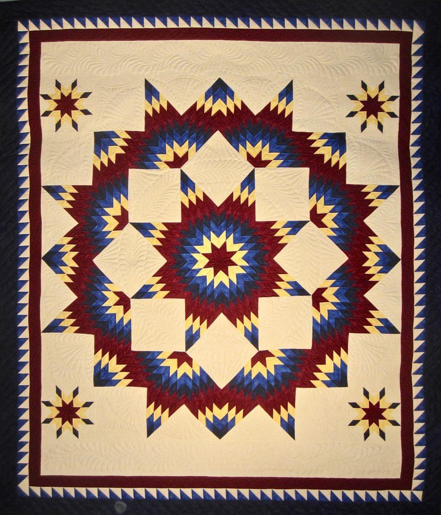 Broken Star NBQA 2015 raffle quilt, pieced by Sharon Meyers